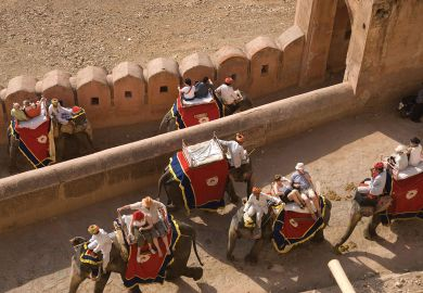 Tourists ride on elephants up to the Amber Fort, Jaipur, India.