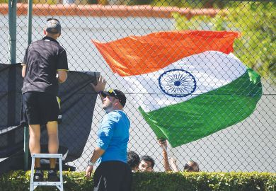The Indian flag flies as ground staff erect netting in front as a metaphor that  Some Antipodean universities face an existential threat from the loss of Indian students.