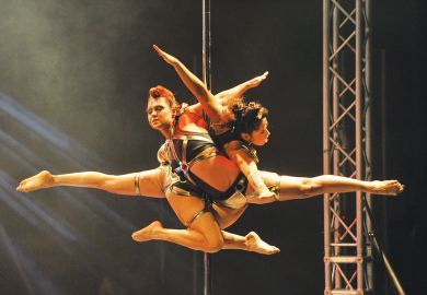 Two performers in the doubles International Pole Championship in Singapore perform together as a metaphor for two main universities of Singapore has brought together its largest and most established faculties.