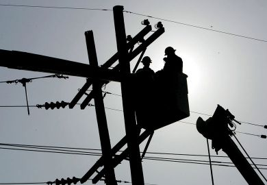 Utility workers repair a power line to show The 10-year programme aims to reshape America's economy by spending big on transport projects, advanced manufacturing and clean energy.