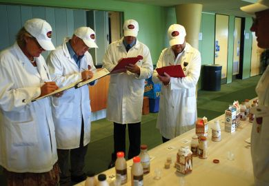 Judges at the Sydney Royal Cheese and Dairy Produce Show assess flavoured milk products