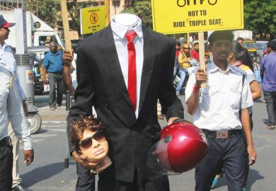 Person dressed headless and holding a dummy head as a metaphor for Indian leadership vacuum raises questions over sector reforms