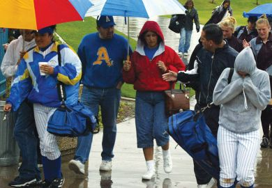 Spectators exit the Woodbridge Softball Classic Tournament which was postponed.