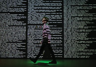 Person stands in a projection of live data feeds.