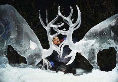 man looking at ice sculpture of two stags with horns together as a metaphor for 'Nordic' innovation vision for Scotland backs university mergers.