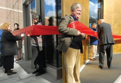 giant red ribbon encircling the Bowdoin College Museum of Art's new building during a ribbon cutting ceremony  people cutting ribbon with adults holding it around them as a metaphor for what I've missed about my former life
