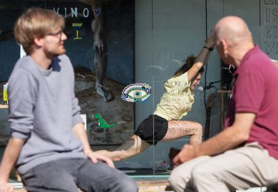 Two people watching an artist doing yoga in a container