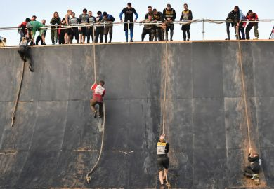 People climbing ropes during the Race of Heroes obstacle course race