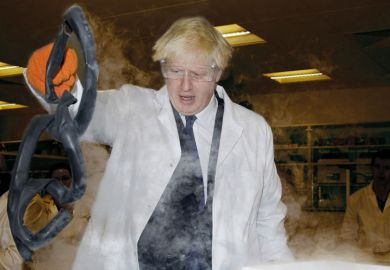 Boris Johnson wearing white coats and goggles