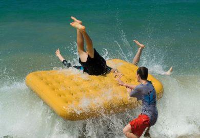 Boys fall off inflatable raft into sea