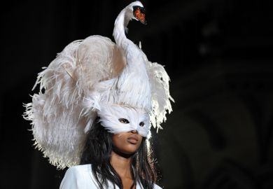Woman wearing swan headdress