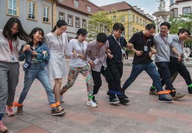 Huawei workers play a 'team building' game at the end of the lunch break at the new sprawling 'Ox Horn' Research and Development campus