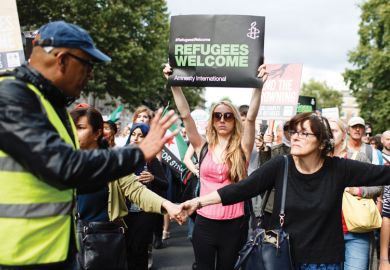 Demonstrators calling for greater government assistance for refugees