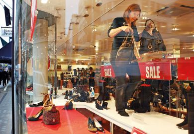 Sale display in shoe shop window