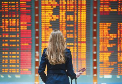 woman at departures board