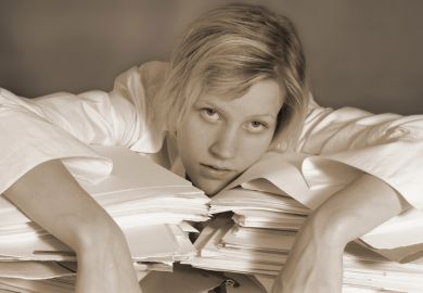 Woman exhausted on papers