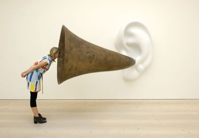 Woman looking into ear trumpet