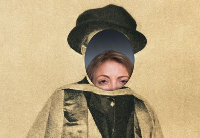 Woman peeking through face of photo of university graduate