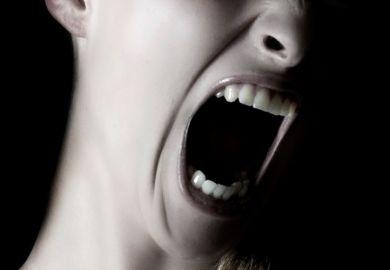 Woman screaming (close-up)