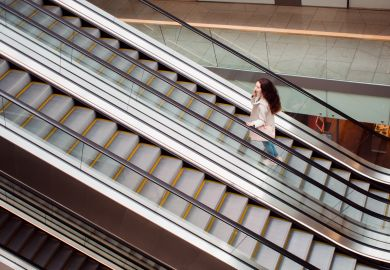 Woman going up on escalator