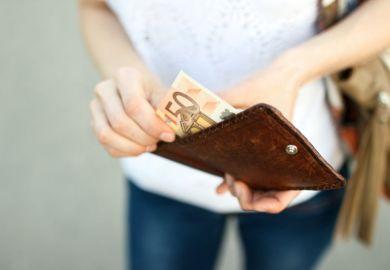 Woman handing over euros