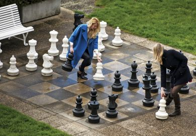 Women play chess on giant outdoor chessboard, Lausanne, Switzerland