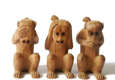 Wood-carved monkeys, see, hear, speak no evil