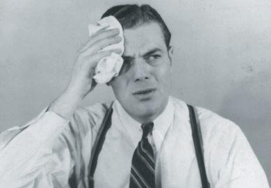 Worried man wiping forehead