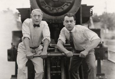 Worried men in front of runaway train