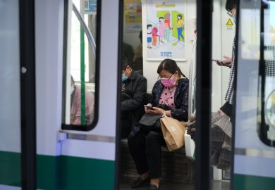 Wuhan China-Oct 2020 passengers in face mask to prevent coronavirus, sitting inside subway train in Wuhan