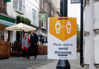 York, UK, England, 24-10-2020, Advisory sign on lamp post in the city Centre advising people observe the social distancing guidelines
