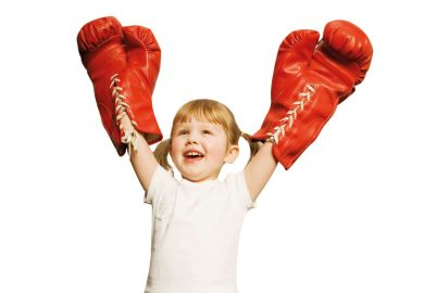 Young girl celebrating boxing victory