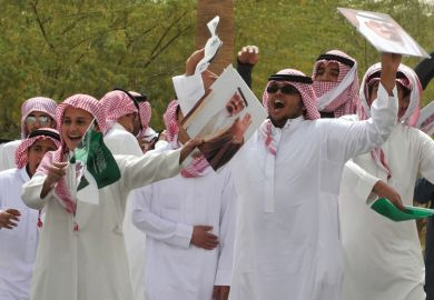 Young Saudi men cheering and celebrating