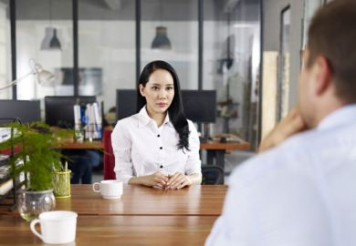 Young Asian woman being interviewed