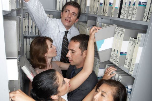 cramped office space. Cut Departmental Selfishness To Costs, Report Advises Cramped Office Space