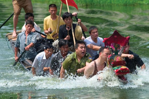 A boat of Chinese students sinking