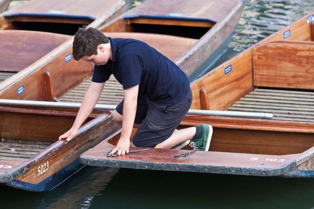 A boy working on the punts at the University of Cambridge