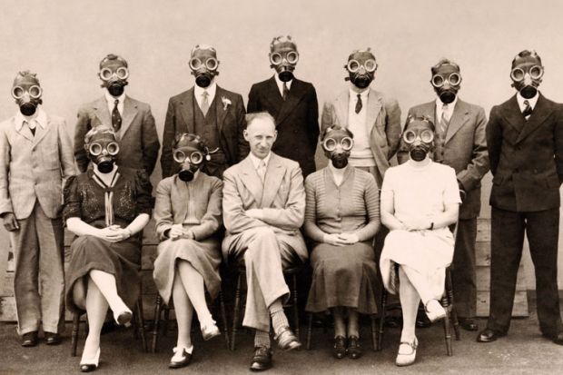 A group of people wearing gas masks