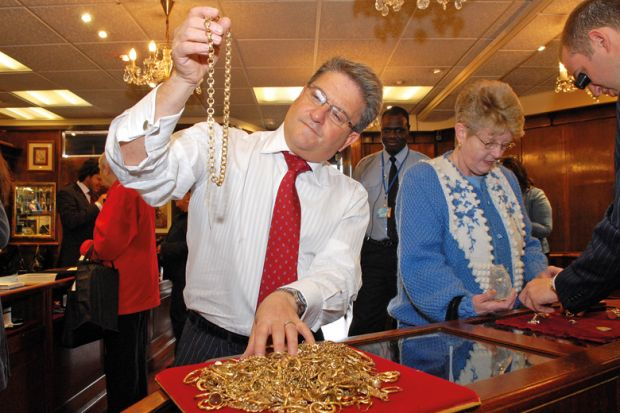 A man inspecting gold jewellery