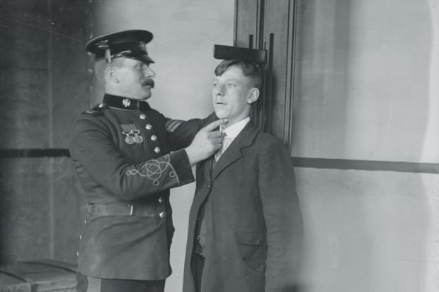 A man measuring the height of another man