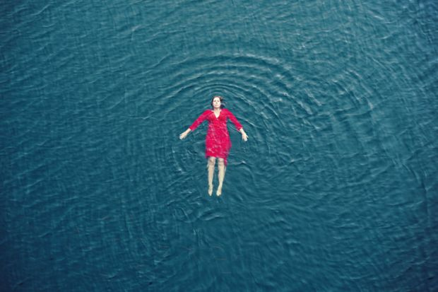A woman floating in the sea