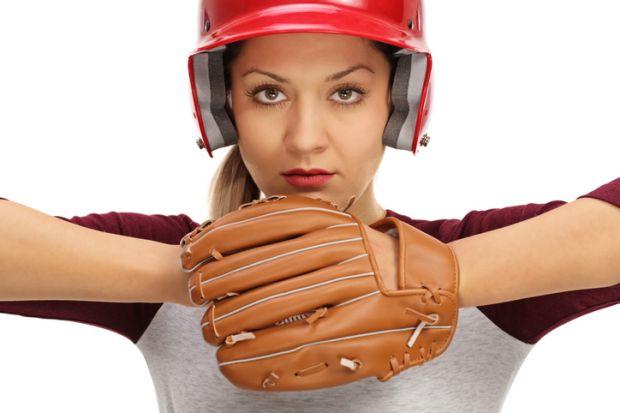 A female baseball pitcher symbolising female leaders