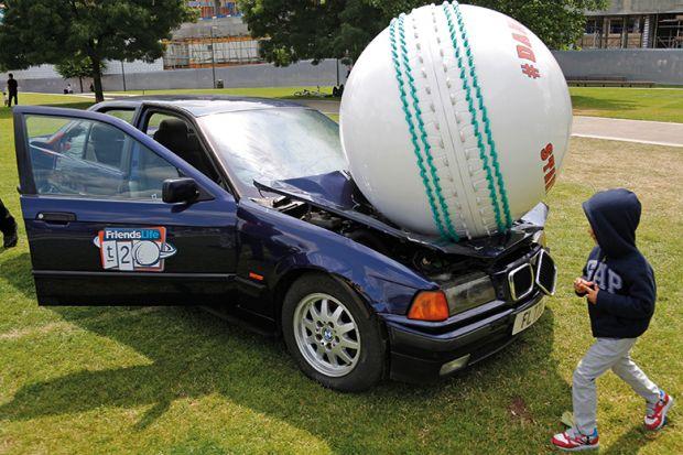 A ball crushing a car