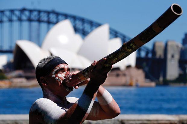 Aboriginal man plays didgeridoo, Sydney Opera House, Australia