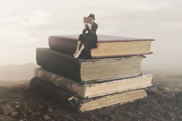 A little person on a pile of books