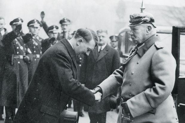 Adolf Hitler greets President Paul von Hindenburg, 1934