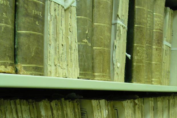 Aged medical journals on shelf