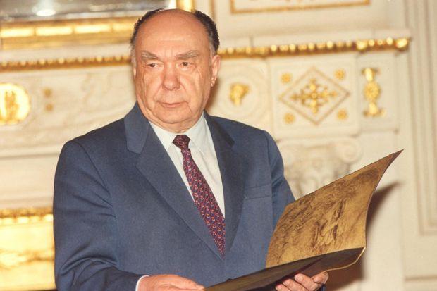 Alexander Yakovlev holding book