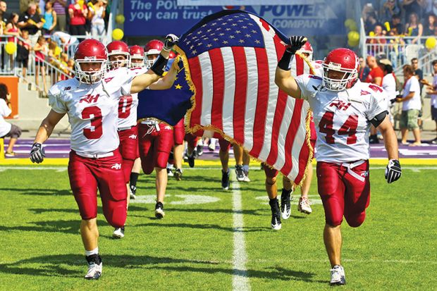 The American football team of Rose Hulman College entering the Hohe Warte Stadium illustrating issues with culture of US college sports