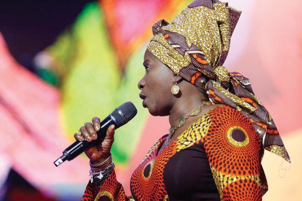 Angélique Kidjo singing on stage